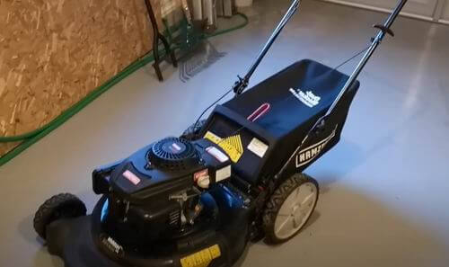 is it safe to store lawn mower in garage